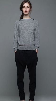 Love a classic sweater and black pants.