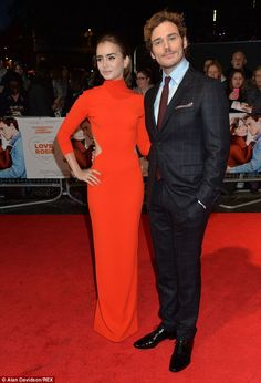 Starry eyed: Sam Claflin posed next to his brunette beauty co-star on the red carpet
