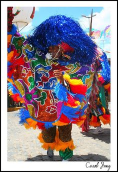 Maracatu Rural is rooted in the Pernambucan interior (in Brazil) and evolved in the early 20th century as a fusion of pre-existing forms of Carnival revelry.