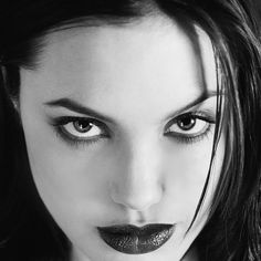 Two photographs of a 20-year-old Angelina Jolie taken by Kate Garner have gone on sale.