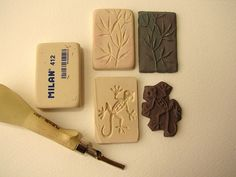 Polymer clay imprinted with carved rubber stamps