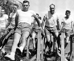 Clark Gable working out on the parallel bars to condition himself for the officers candidate test. He is trying for a commission in the Army Air Force at the Candidate School in Miami. September, 1942