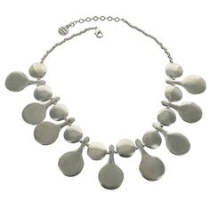 Alternating large paddle shaped and round silver elements make up this fabulous necklace from the streets of Paris. Designed by Bernard Bouhnik for Metal Pointus and distributed by Potluck Paris. - Ma