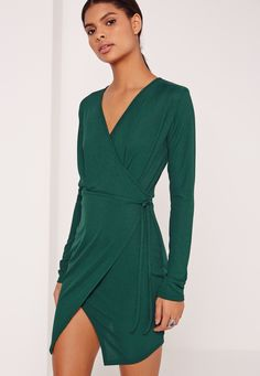 Amp up your oh-so-chic day look in this ribbed shift dress - featuring a bottle green hue, wrap front and a tie waist fasten.