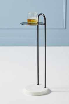 Featuring a modern, steel-crafted design with a touch of timeless marble, this end table is a sophisticated perch for mixed drinks and cocktails. Unique Living Room Furniture, Steel Furniture, Home Furniture, Modern Furniture, Furniture Design, Metal Side Table, Modern Side Table, Side Tables, Drink Table
