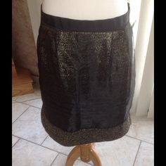 Loft Mini Skirt Black and Gold metallic tweed skirt with a black sheer overlay skirt by Ann Taylor Loft. Black piping about three inches from the bottom.  Fully lined.  Measurements laying flat: Waist 16 inches, Hips 21 inches, Length 19 inches. NWT(PB1) Ann Taylor Loft Skirts Mini