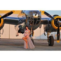 Sexy 1940s pin-up girl in lingerie posing with a B-25 bomber Canvas Art - Christian KiefferStocktrek Images (35 x 23)