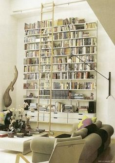 Book shelving- tall enough to need a ladder without being dark and overbearing. Since it floats, cleaning or even changing out the flooring is easily doable.
