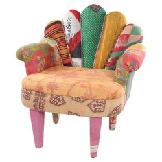 One-of-a-kind peacock chair with mango wood frame. Upholstered with reclaimed Kantha throws.   Product: ChairConstru...