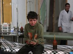 SYRIA, Douma : A wounded Syrian boy cries at a makeshift hospital following a reported air strike by government forces in the rebel-held area of Douma, east of the capital Damascus, on November 18, 2015. AFP PHOTO / ABD DOUMANY