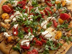 Pizza Ree-A Recipe from Food Network—looks like this is worth a try...could just do our normal garlic salt on Max's crust Pizza Ball, Pioneer Woman Recipes, Balsamic Glaze, Fresh Mozzarella, Ree Drummond, Basil Pesto, Garlic Butter, Roasted Tomatoes, Food Network Recipes