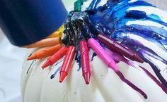 Melted wax crayons on a pumpkin head