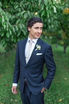 Chic Groom in a Navy Blue Suit | Royce Sihlis Photography and Created Lovely Events | Sparkling Blush and Champagne Wedding in an Apple Orchard