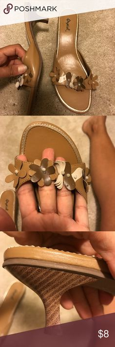 Tan flowered pumps. Worn once! These are so cute to wear with shorts or any summer dress/skirt. Size 9. They are in excellent condition because I only wore them one time to church. Shoes Heels