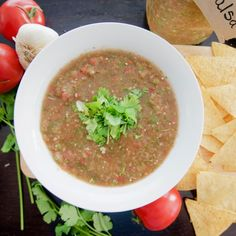 Quick and easy tomatillo salsa made in a blender. Flavor packed and perfect to take to any party.