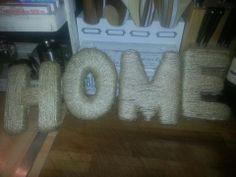 van karton letters knippen en die inwikkelen in sisal touw