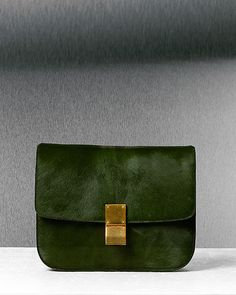 Am loving the pine-ish green and gold mix. Kind of a 70's color palette but so sleek and modern. CÉLINE  2012 Fall collection