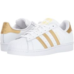 Amazon.com | adidas Originals Women's Superstar W Sneaker,... (234.620 COP) ❤ liked on Polyvore featuring shoes, sneakers, wide width sneakers, gold metallic sneakers, metallic gold shoes, white trainers and white gold sneakers