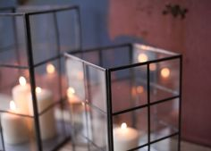 Seba Storm Lantern   Adorn your home or garden with these striking glass storm lanterns. Each glass and metal candle holder is handmade by a skilled metal artisan. These gorgeous pieces also look great as decorative display pots.