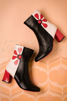 These 60s Strawberry Fields Forever Bootieswill complete your 60s mod look perfectly! These cuties are simply irresistible! Made from top quality black and cream coloured 'faux' leather and as eye-catcher a playful button with petals and a comfy block heel in orange red... wow! Already feeling the 60s vibe?! ;-)   Round shoe nose Comfy block heel Zipper on the side Comfy insole