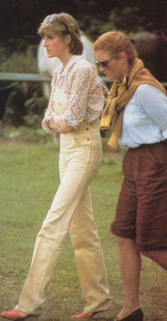 Yellow overalls & coral wedges. With Sarah Ferguson. 1981./....Wonder if even then she had reservations about this relationship and if it could work. Probably too early in the engagement for her to be wary of Camilla, who was making herself known to the young lady even at this stage.