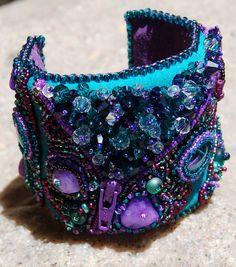 Handmade Bead Embroidered Cuff / Bracelet with Swarovski Crystals. $280.00, via Etsy.