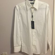 NWT!! Dolce and Gabbana Men's Dress Shirt NWT Slim Fit. 15 1/2 neck. Tag says: Size 39 European (which translates to 15 1/2). Made in Italy. Dolce & Gabbana Tops Button Down Shirts