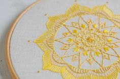 Hand Embroidered Mandala Hoop Art based on my original drawing of the Solar Plexus Chakra.  I designed and created the original piece as I was learning all about the Chakras. I love the ten petalled outline of the design and the 3 tone yellow of the embroidery silks that really make this a cheerful and peaceful piece to have in the home.  The Solar Plexus Mandala represents Vitality, confidence, will, joy and sweetness and its yellow colour is symbolic of the fire that burns within us all…