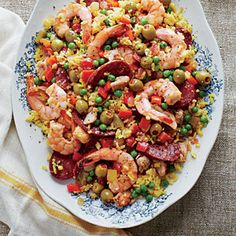 We streamline Paella, a popular Spanish one-dish meal, by cooking it in the slow cooker. The sausage and chicken are first sauteed in a skillet for browning and flavor. Mexican chorizo is made with fresh pork, while Spanish chorizo is made with smoked pork.