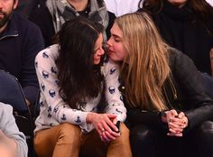 Michelle Rodriguez Gives Cara Delevingne a Sloppy Kiss at NBA Game, Then Does High Kicks With Gal Pal