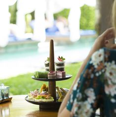 Looking for perfect way to spend an afternoon?, High tea is always perfect!....#theelysianbali #theelysianexperience #seminyakrestaurant #rushbamboorestaurant #holiday #hightea #teatime #bali #indonesia #afternoontea #poolside #tropicalvilla #poolvilla #hotelresort #relaxation