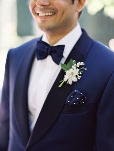 Navy blue suit + bow tie