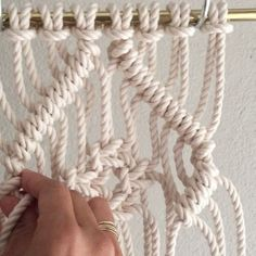 How to Tie a Square Knot Diamond inside a Clove Hitch Diamond // This video shows you how to tie a few Square Knots inside a Clove Hitch Diamond. It is decorative and used in Macrame wall hangings and Jewelry. // This video shows 8 cords at 5 feet each. Since folded in half and attached using the Larks Head Knot there are now 16 cords; 1-16 from left to right. For the sake of time, I tied one row of Diagonal Clove Hitch knots using cords 1-8 and 9-16, which I'll explain how to do below…