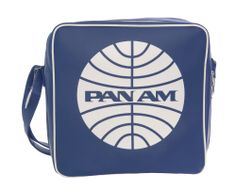 This Pan Am Originals Defiance bag features an outer shell of PVC and is embossed with the famous Pan Am globe logo. The interior features an airport print lining, a YKK zip pocket and a base with a snap hinge so that the bag can flatten for easy storage. Included is a fully adjustable shoulder strap, as well as a velcro slip pocket on the back side of the bag. The Defiance is the same type of bag seen on The Beatles when they arrived in America for the first time.
