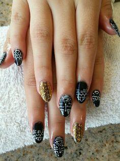 Stilleto nails Black & gold with tribal nailart