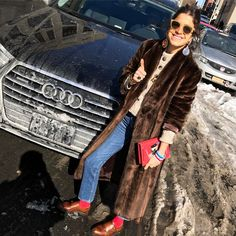 Channeling a Milanese woman/how am I doing? Standing in front of my free ride for the week sorry you're so snowy today @Audi #nyfw #mrpartner #hello #icecream