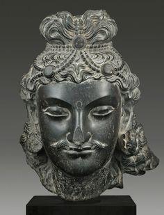 Head of Bodhisattva, Ghandara, 2nd–3rd century A.D. Schist, H: 31.1 cm © Phoenix Ancient Art