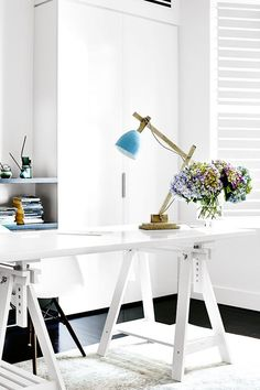 I think I could be very happy in a work space like this - clean lines, fresh flowers, lots of space to think.