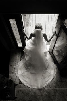 I love this image from above of the back of the wedding dress.  And its like she's passing through the door onto a new life. Very powerful in B/W