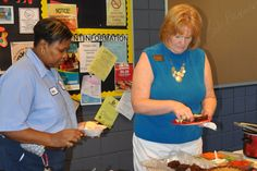 Jo Ella White and Marcia Norwood enjoy some of the fine food from the covered dish lunch.