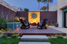 A home in Phoenix, Arizona has many cool design features, including the ceramic agave on the wall, from artist Jim Sudal Studio. The Manta Ray Gas Fire Pit was sourced from Woodland Direct. It is nestled in an acid wash concrete ring, about 8″ high and 6″ wide with river rock. The Loll Designs Collection chairs (Emmet Lounge and Rocker) were sourced from Room & Board.