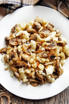 {Healthy, Low Calorie, Gluten-Free, Vegan} This simple and flavorful mushroom cauliflower stir-fry is a versatile side dish, great for any occasion.