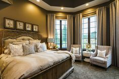 Dream home master bedroom! Rustic and elegant with pair of chairs and custom drapes. Gorgeous panel bed. Fluff Interior Design - Decorating for REAL life! Omaha, NE.