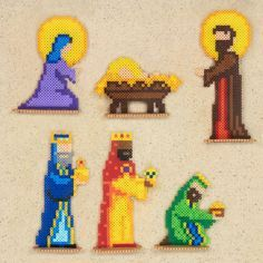 This tender Nativity scene features the Holy Family, 3 Wise Men, 2 shepherds, the angel, and a host of animals in mini beads. Designed by Kyle McCoy. Melty Bead Patterns, Pearler Bead Patterns, Perler Patterns, Beading Patterns, Christmas Perler Beads, Perler Bead Designs, 8bit Art, Beading For Kids, Peler Beads