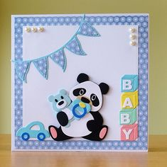 A lovely card to celebrate the birth of a baby girl or baby boy handmade in Wakefield, West Yorkshire. It features a cute panda with a dummy holding a small teddybear. The blue boy card also has a blue toy card near the panda whilst the pink girl card has a pink rattle. The card has