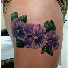 What does violet flower tattoo mean? We have violet flower tattoo ideas, designs, symbolism and we explain the meaning behind the tattoo. Pansy Tattoo, Hibiscus Tattoo, Flower Tattoo Back, Flower Sleeve, Lotus Tattoo, Arm Tattoo, Violet Flower Tattoos, Violet Tattoo, Bad Tattoos