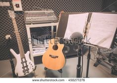selective focus the  microphone and musical integuments the guitar,lyrics, drum,bass,speakers,sound music mixer background. music production band concept. #450277276