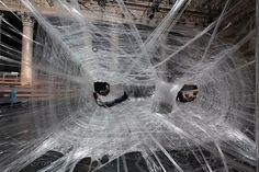 Cocoons made entirely of shipping tape suspended in mid-air within a former stock exchange building in Vienna is one exhibition in Berlin's 8th annual DMY International Design Fair.