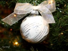 Keepsake Christmas Ornaments♥    Find an old paperback, tear out some pages, and cut them into strips. Use an old devotional, and cut out the bible verses.           Stuff the strips into the glass ornament and used the eraser end of a pencil to move them around.          When the ornament is full, give it a few shakes to settle the paper strips. Replace the top and tie on a ribbon.