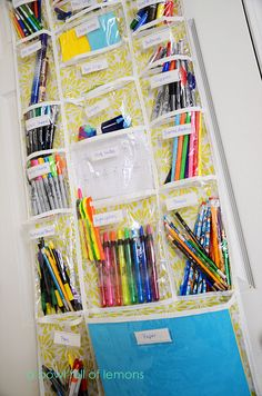 This is so smart. Over the door, labeled school supply storage. You can see everything at a glance. No overflowing messy drawers...just clear vertical organized loveliness!